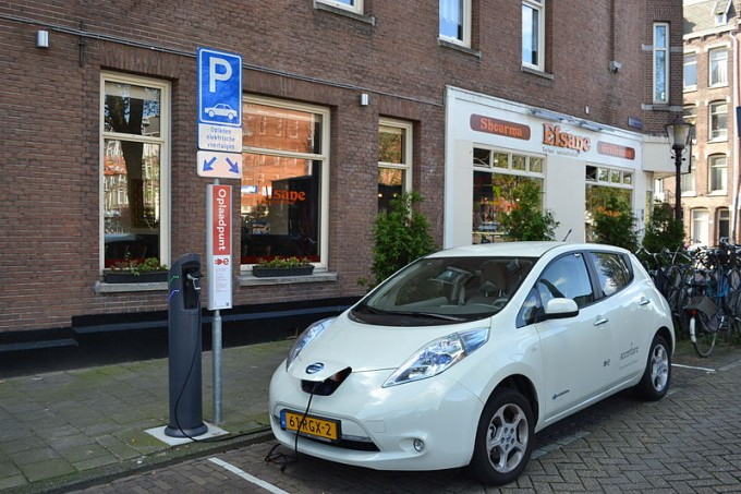 A Nissan Leaf charging in Europe, where charging stations, unlike the present-day United States, are common