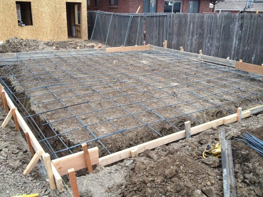 Project update narrow urban houses in denver evstudio for Slab on grade ontario