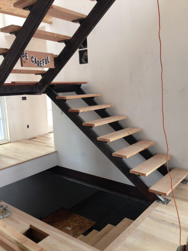 a structural gem custom steel staircase nearly complete main floor stair